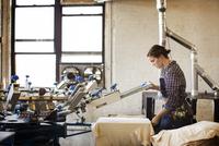 Woman working in printing workshop
