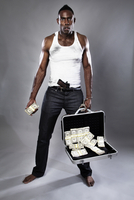 Criminal with briefcase full of money and gun