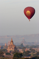 Hot air balloon over temple