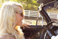 Portrait of young woman driving in convertible