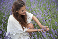 Woman picking lavender in filed
