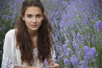 Portrait of young woman in flower field