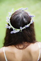Rear view of young woman wearing lavender wreath