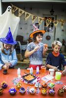Children (10-11) preparing food for Halloween