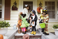 Children (2-3, 4-5) collecting sweets on halloween