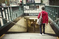 Teenager entering metro station