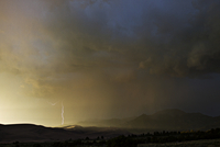 Scenic landscape with mist and thunderstorm dramatic sky