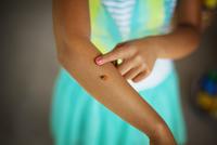 Girl with ladybug on arm