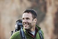 Mid-adult hiker looking away