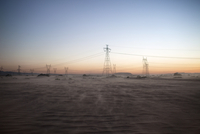 Electricity pylons in desert