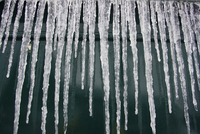 Icicles hanging by window