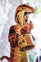 Boy (4-5) wearing dinosaur costume