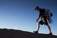 Man hiking with climbing gear