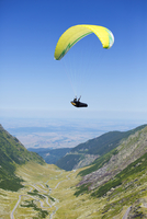 Man parachuting over valley