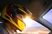 Head of racecar driver in sunlight