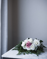 White rose bouquet with one pink rose