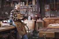 Carpenter using tablet in workshop