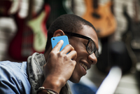 Man wearing glasses talking on phone