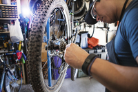 Man repairing bicycle in workshop