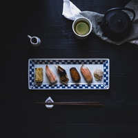 Sushi and matcha tea on table