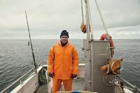 Portrait of fisherman on boat