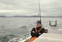 Fisherman sitting on boat