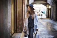 Young woman carrying shopping bag