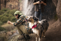 Two young men and dog in mountains