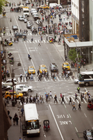 High angle view of people crossing city street