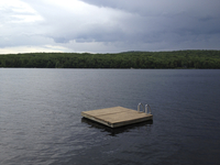 Floating platform on lake against cloudy sky