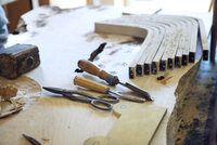 Close-up of wooden planks and tools on workbench