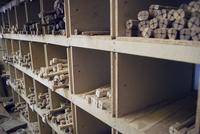 Wooden rods arranged in shelves at workshop