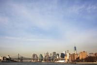 Manhattan Bridge and skyline against sky
