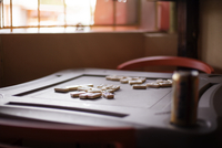 Dominoes on table by window in room