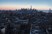 One World Trade Center amidst cityscape during sunset