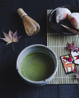 High angle view of matcha and Japanese rice cake on table