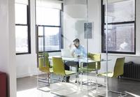 Creative businessman using laptop in board room