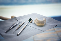 Close-up of dentures and tools on table at clinic
