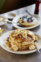 Pancakes served with banana slices in plate