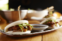 Close-up of pork buns served in plate on table