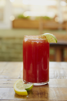 Close-up of Bloody Mary served in glass jar with lemon slices on table