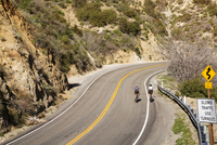 High angle view of friends cycling on mountain road