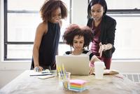 Businesswomen using laptop in creative office