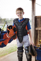 Portrait of confident baseball catcher at field