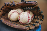 Close-up of baseballs in catchers mitt