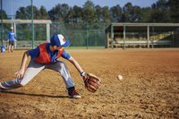 Boy playing baseball on field
