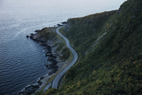 High angle view of mountain road by sea