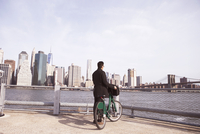 Businessman with Citi Bike enjoying city view from observation point