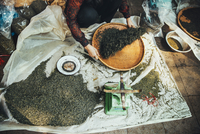 High angle view of vendor winnowing food at street market