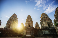 Low angle view of Angkor Wat temple against sky during sunset